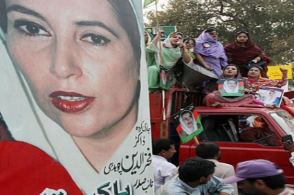 Poster of Benazir Bhutto surrounded by supporters during a rally in Pakistan